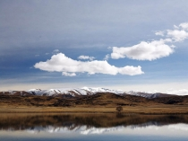 Into_the_Wider_World___Mt_St_Bathans_the_highest_peak_in_Central_Otago_from_Falls_dam_in_the_upper_Manuherikia_valley