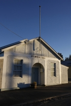 Early_morning_light_on_Oturehua_Hall_Central_Otago_showing_flagpole