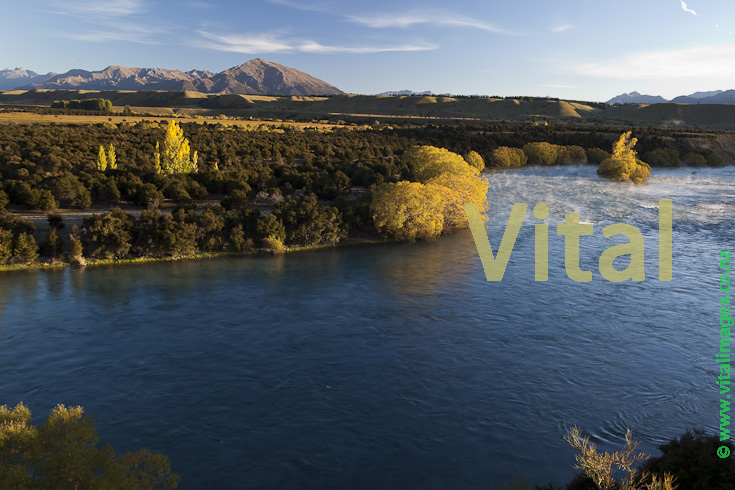 Autumn in Central Otago | the mighty Clutha River above the red bridge at Luggate Central Otago near Wanaka Airport