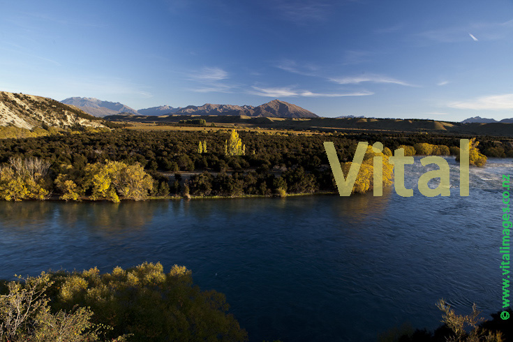Natural NZ landscape the mighty Clutha River above the red bridge at Luggate Central Otago near Wanaka Airport
