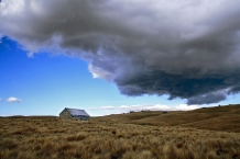 Brooding_Cumulus_Cloud_over_Historic_Serpentine_Church_on_Rough_Ridge_Central_Otago_The_Presbyterian_Church_above_Lake_Onslow_was_built_by_public_subscription_f