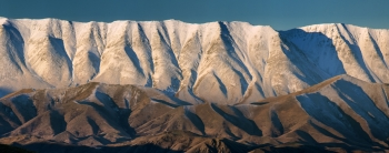 Light_Dusting_of_Snow_and_winter_light_on_Mt_St_Bathans_amp;_The_Chain_Hills_above_the_Lindis_Valley_Central_Otago