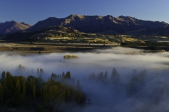 Early_Morning_Autumnal_Fog_over_the_Clutha_River_near_Albertown_Central_Otago_looking_towards_Mt_Alta_and_the_Buchanan_Range