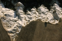 Texture_created_by_tracks_on_barren_field_and_eroded_volcanic_rock_above_Cappadocia_in_Central_Turkey